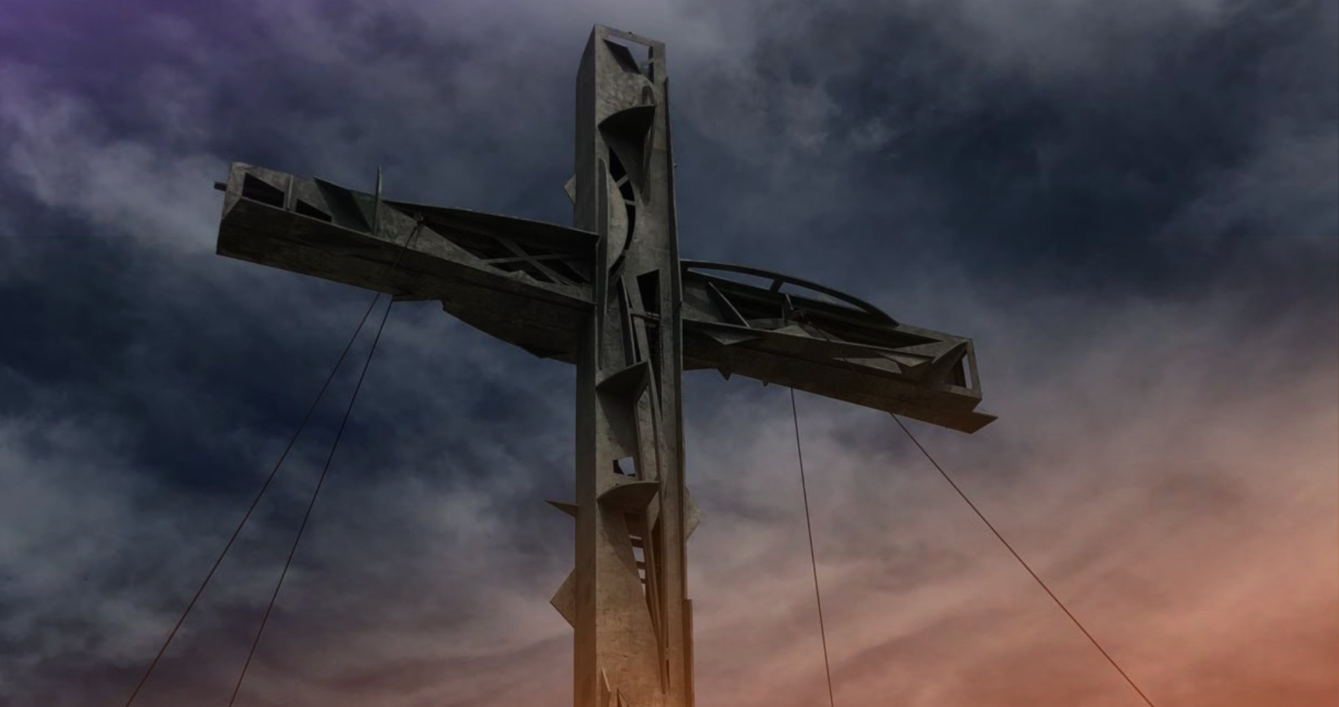 cross against a clouded sky