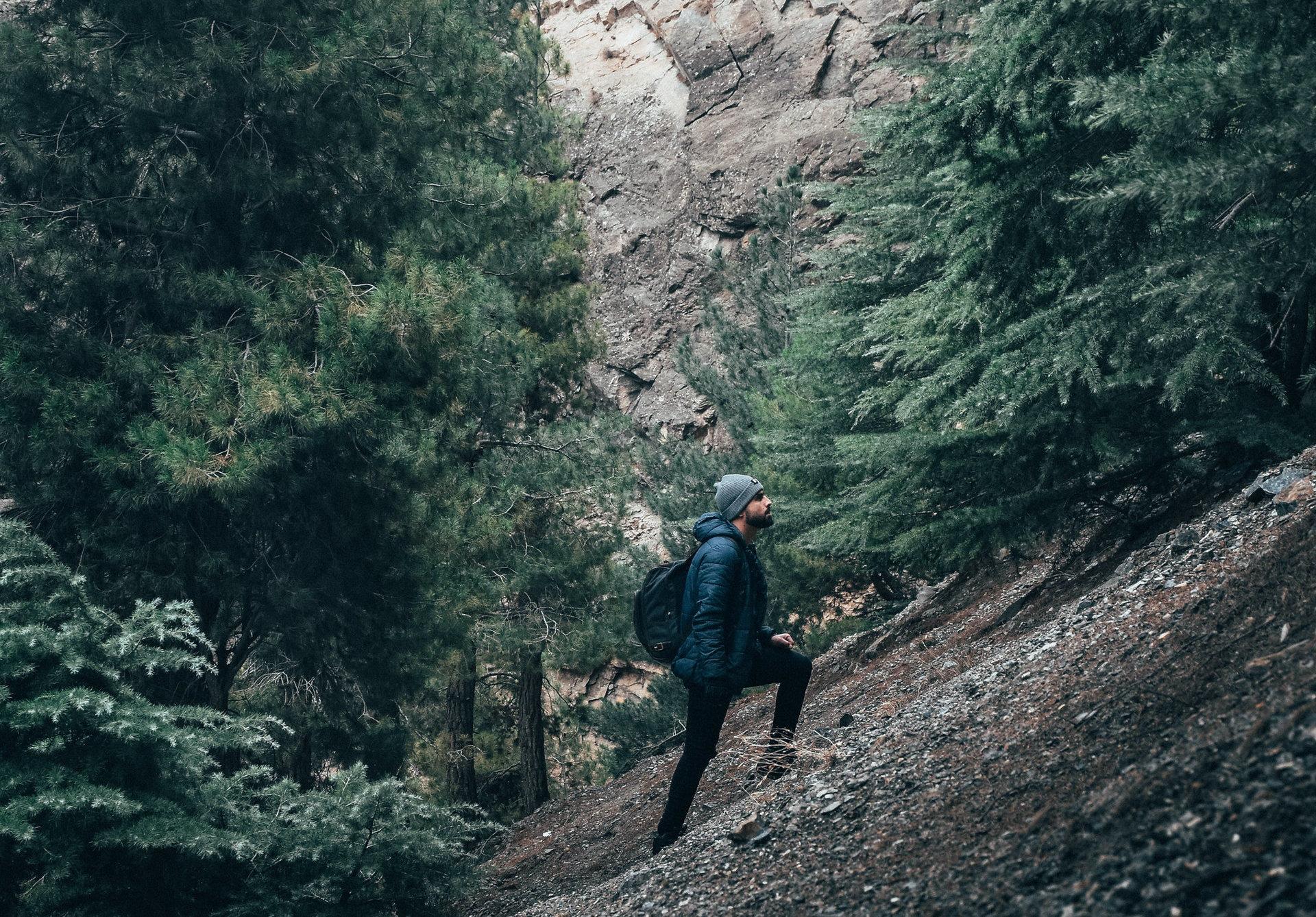 man climbing incline