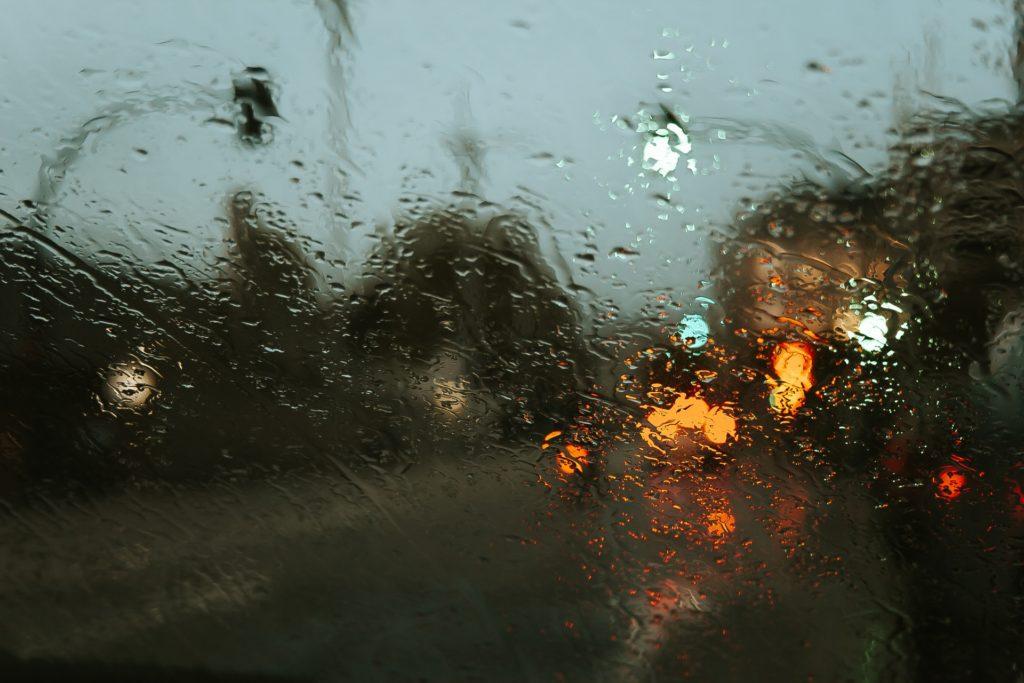 street scene through rainy window