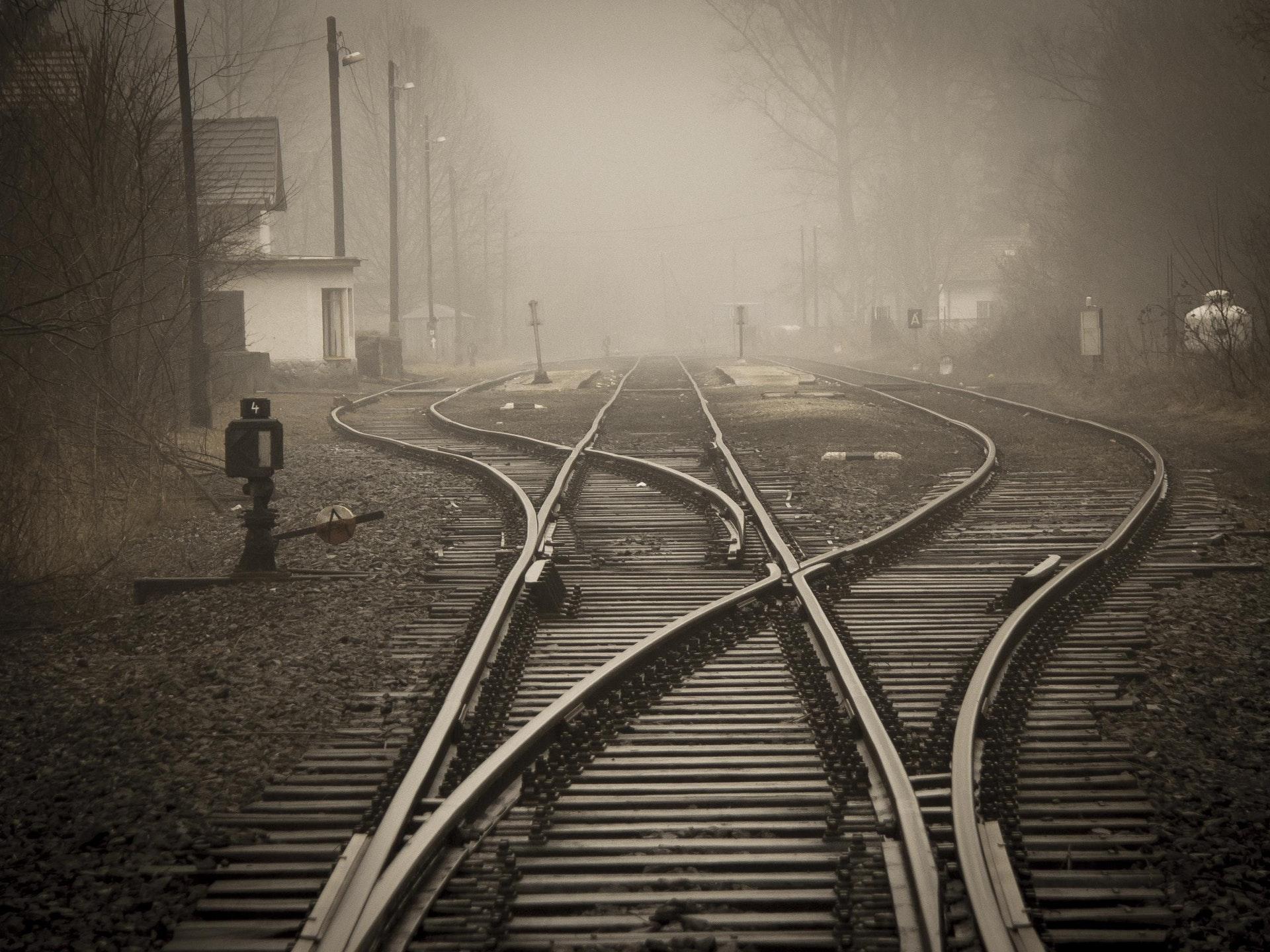 three railroad tracks converge