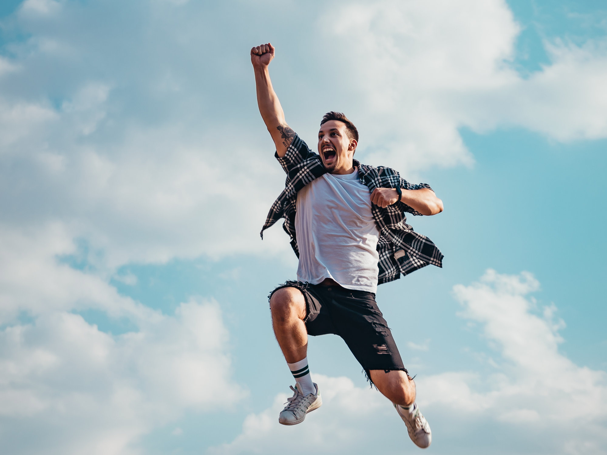 man jumping with fist in the air